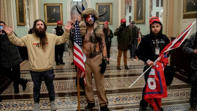 Pro-Trump Supporter Known as 'QAnon Shaman' Asks Trump For Pardon After Storming Capitol